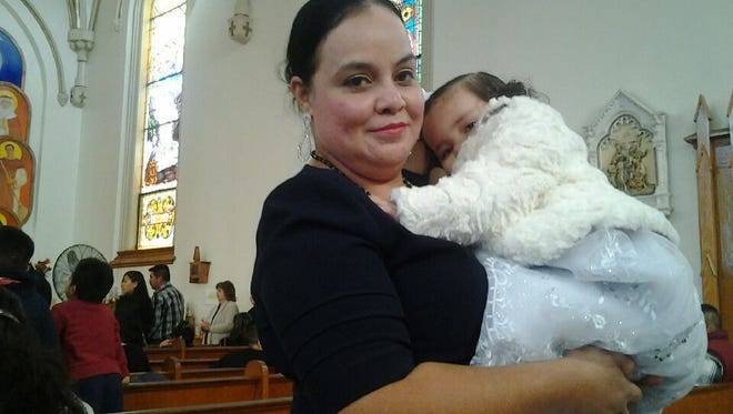 Maribel Trujillo-Diaz, the Fairfield mother of four children, who is scheduled for deportation back to her home country of Mexico on April 19, 2107.  She is pictured her in church with her youngest child.