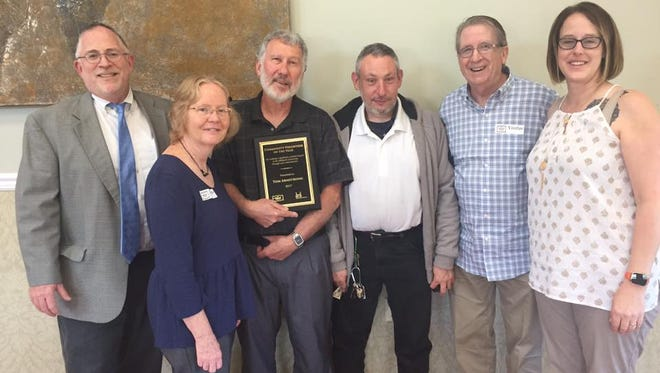 The 2017 Community Volunteer of the Year, Tom Armstrong (center left), with (from left) Midland President and CEO Shawn McInerney, his wife, Barbara Armstrong, Midland group home resident Jason, former Midland Executive Director Phil Gartlan and Midland Residential Director Stacey Gravina.