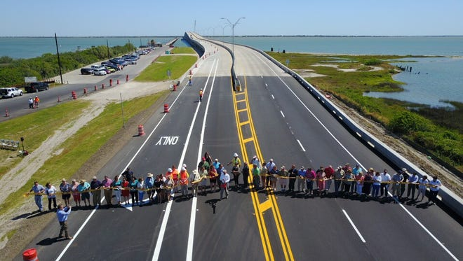 Area leaders and Texas Department of Transportation authorities cut a ribbon on the new Copano Bay Causeway on Monday, May 1, 2017.