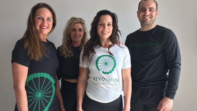 From left, Colleen Schurrer, Jennifer Tuttle, Brooke Moeckly and Braden Bradfield recently opened Revolution Yoga & Cycle Studio on 3824 S. Western Ave. in Sioux Falls.