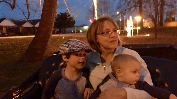 Bev Brown holds grandsons Miles Doyle and Owen Doyle.