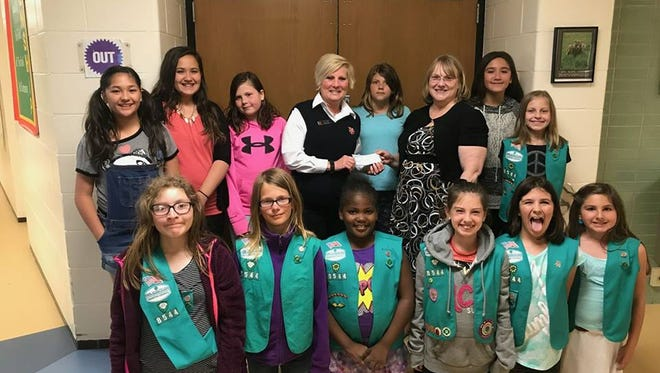 Girl Scout Troop 8544 poses with Salvation Army of Manitowoc County Lt. Terri Olson and Troop Leader Patricia Koppa after donating $500 to help the Parkview Haven fire victims.