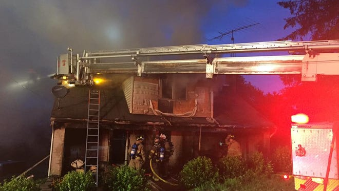 Firefighters responded to Lake Road around 5 a.m. Saturday for a report of a structure fire. A family of four was displaced and firefighters rescued two dogs from the home, officials said.