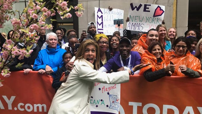 Alexandria Middle Magnet students started off one of their days in New York on  NBC's TODAY Show. They are shown holding up signs with TODAY host Hoda Kotb.