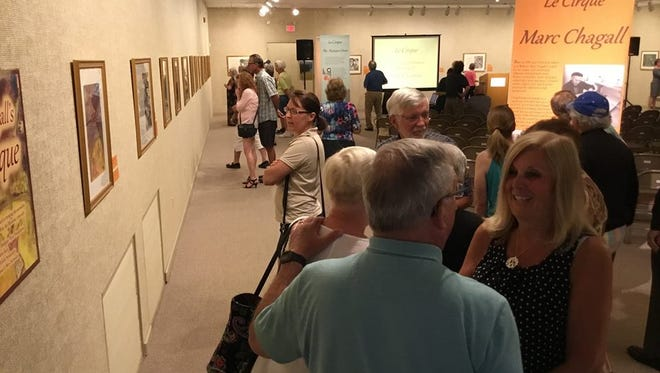 The Le Cirque exhibit at Rahr-West Art Museum will remain on display through Aug. 13. Pictured, more than 200 people attended the exhibition's opening Sunday.