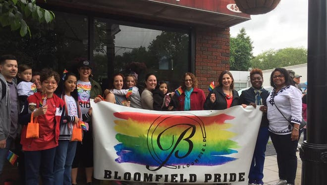 Members of Bloomfield Pride come together for the municipal Memorial Day Parade in 2017.