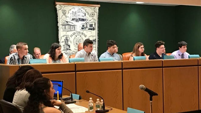 Hawthorne High School students sit at the dais June 7 in Hawthorne Borough Hall and run the council meeting as part of youth week.