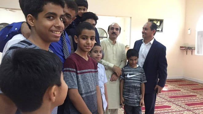Children gather inside the Islamic Society of Brevard mosque shortly after a special Ramadan service last year.
