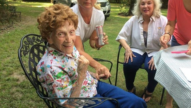 Mary Frances McHam and other family gather for her 102nd birthday. McHam, who was born in Wichita Falls, celebrates with her.daughter Sandie Light, seated at the table.