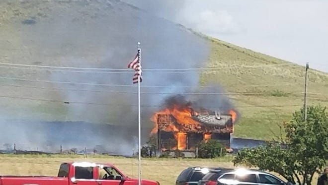 An abandoned home burned to the ground Monday on Hill 57. Because the house was full engulfed by the time fire crews arrived, agencies responding to the blaze decided to let the structure burn.