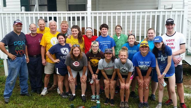 The whole St. Michael youth mission group in front of the porch they painted and put a new roof on. Standing leaning in: Lori Anne Beimesche-Fothergill, Taylor Shawver, Isabel Baumgartner, Abby Sharpshair, Margaret Sharpshair, Isabel Dougherty. Standing upright in back - John Asbrock, Ed Jansing, Chuck Gibson, Les Shawver, Michael Abele, Rosalie Misleh, Caroline Moore, Logan Goeppinger, Grace Fothergill, Taylor Fothergill, Christine Herman and Alex Lambert.