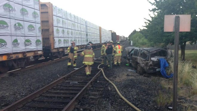 A man was injured after his vehicle crashed into a train on Friday.