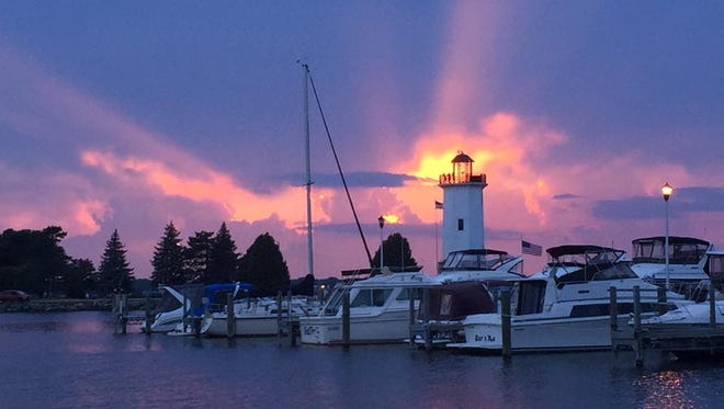 A sunset behind the Fond du Lac lighthouse in Lakeside Park.