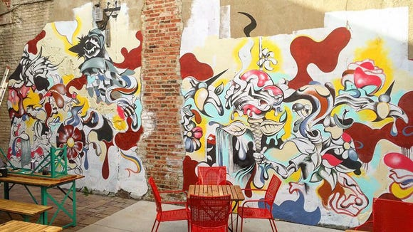 Last summer, Shaine Schroeder completed a mural on the patio of M.B. Haskett in downtown Sioux Falls.