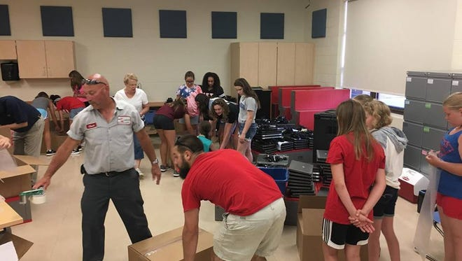 Girl Scout troops from Port Clinton helped pack the computers up last week. In total, PC schools put together four palettes of the aging but functional spare computers, which were then shipped to the Dominican Republic.
