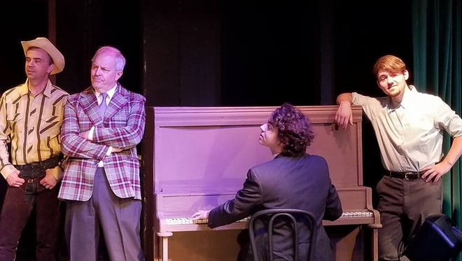 Daryl Grady (Carl Olson, second from left) ponders events at a rehearsal involving castmates (from left) played by John Hemphill, Will Johnson and Elijah Kendziora.
