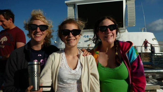 Lynn Gracie-Rogers and her daughters on a cruise in Australia to see a total eclipse in 2012.