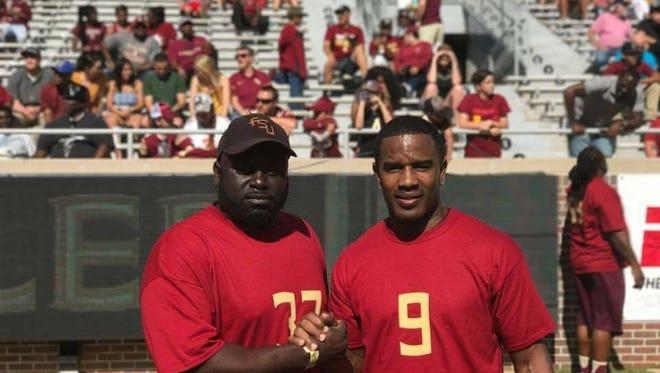 Kendrick Scott with former Seminole Peter Warrick.