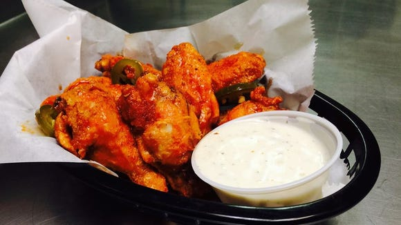 A plate of flavorful but hot Super Boss Wings from