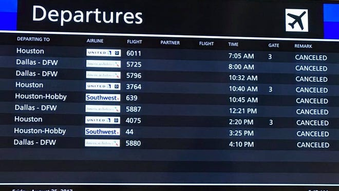 This image provided by the Corpus Christi International Airport shows  a departure board full of cancellations for flights on Aug. 25, 2017.