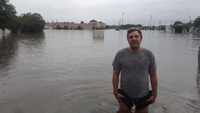 Kenny Easton stands in the parking lot outside his apartment in Houston.