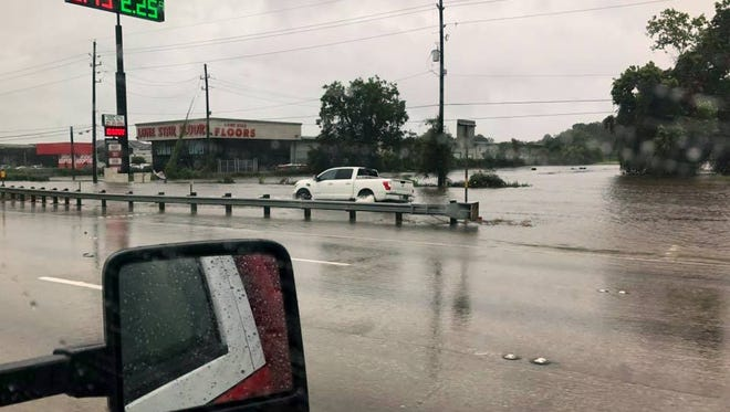 A Wichita Falls Fire Department vehicle drives in through a flooded area of South Texas recently as part of the Wichita Falls area's incident management team. Members of the WFFD, Wichita Falls Police Department, Burkburnett Volunteer Fire Department and Sheppard Air Force Base were deployed as part of the relief effort.