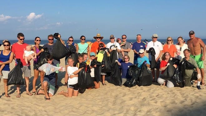 Volunteers line up with their trash collection after last year's Ocean Conservancy cleanup in Ocean City.