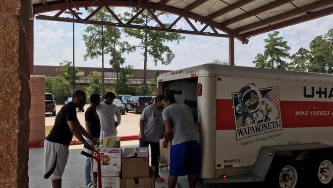 Timothy and Sonya Sloan, along  with three others, load a trailer with hurricane relief supplies at St. Luke Missionary Baptist Church in Humble, Texas.