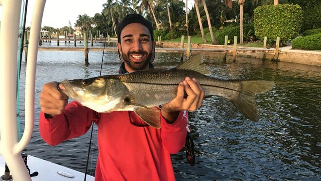 J.J. Follano, of Port St. Lucie, fished with Mark Cieslinski, of Port St. Lucie, on Friday to get a start on the fall snook season. Fallono caught this slot-sized snook near the St. Lucie Inlet, but he let it go, keeping another instead.
