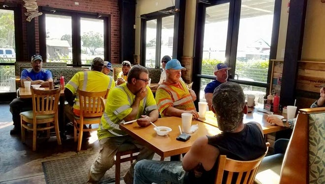 First responders and FPL lineman,working through Irma's aftermath, relax a bit at Okeechobee Tin Fish, where they were served free meals in appreciation for their service.