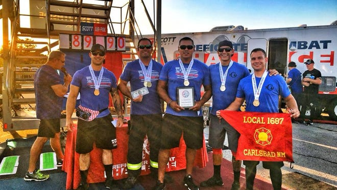 Members of the Carlsbad Fire Department Combat Challenge team, celebrate a victory at the national competition in Tyler Texas.
