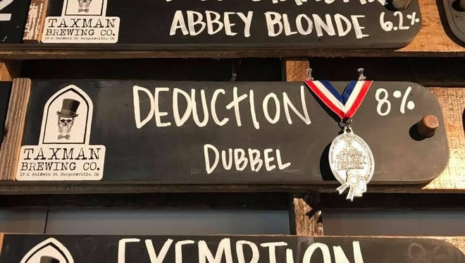 Taxman Brewing Co. in Bargersville hangs its GABF silver medal next to its sign for Deduction, a Belgian Dubbel.