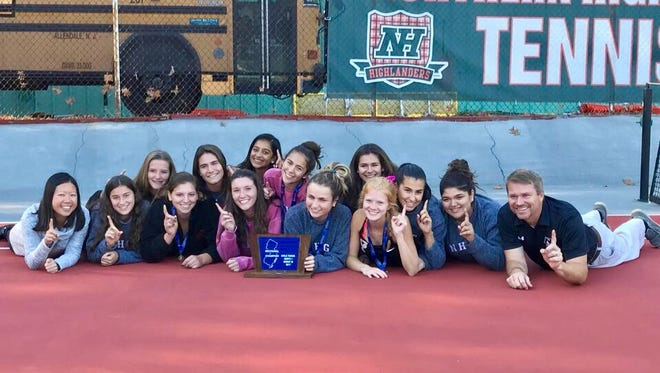The Northern Highlands girls tennis teams poses with the North 1, Group 3 championship trophy on Tuesday, Oct. 17.