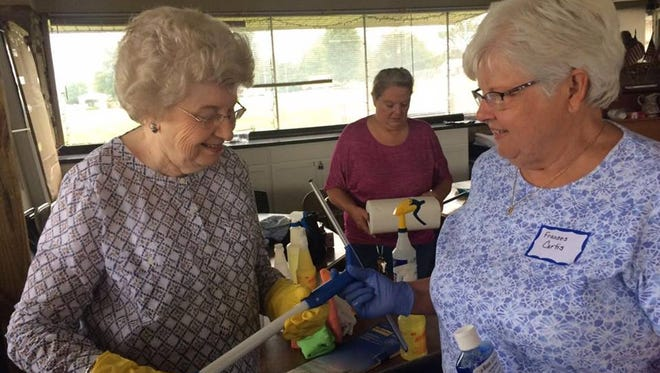 Helen Marshall and Frances Curtis gather supplies while Joyce Wilford of the Sumner Co. Veteran's Home helps out.