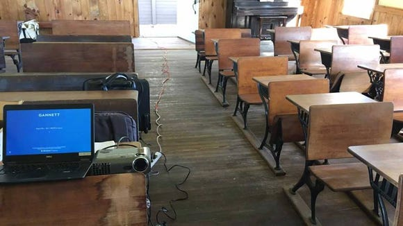 The Felton Fire Co. provided a generator to run the laptops and projectors. This one-room school still has no electricity. Quite a day - the old and new. The cord, by the way, was later routed to an untraveled, side aisle.