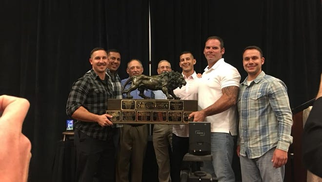 Members of the Carlsbad Fire Department accept their national championship trophy, Oct. 26, in Louisville, Kentucky