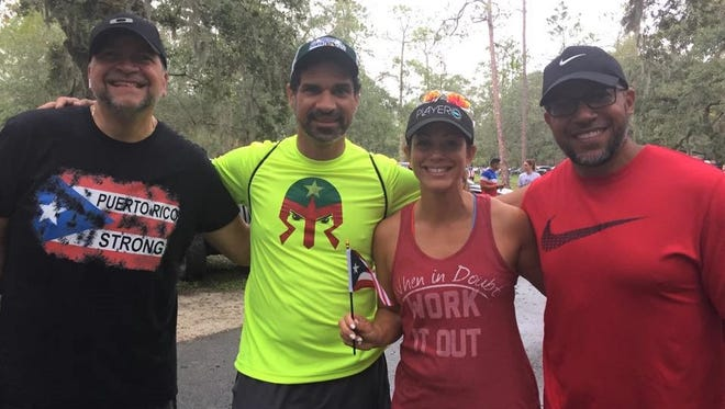 Some of the Ragnaricans participating in the Melbourne Beach to Miami Beach Ragnar Relay are, from left, Melvin Rodriguez, Henry Matta, Glorymar Melendez and Angel Pastrana.