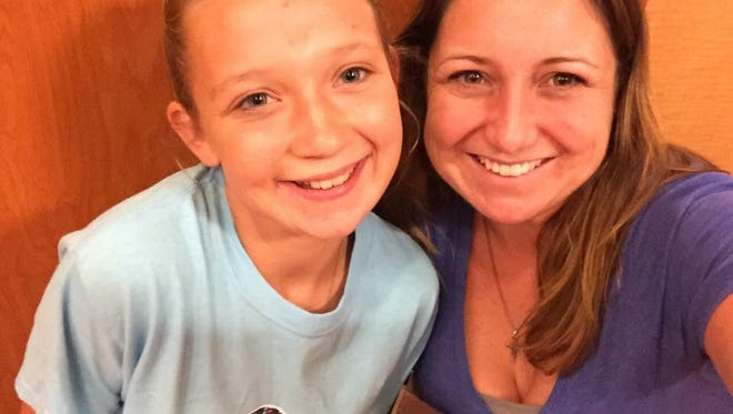 Tara McNulty, right, takes a photo with her daughter, Hailey. McNulty was killed Sunday in the shooting at First Baptist Church in Sutherland Springs, Texas. Hailey was also wounded in the shooting but is expected to recover.