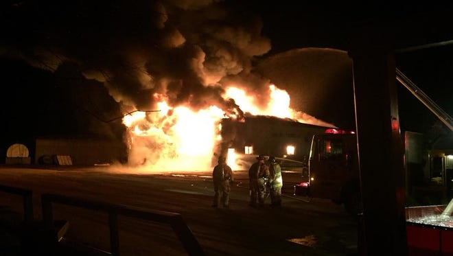 Flames engulf a machine shed at Bach Farms in Dorchester. The fire resulted in a total loss of the building.