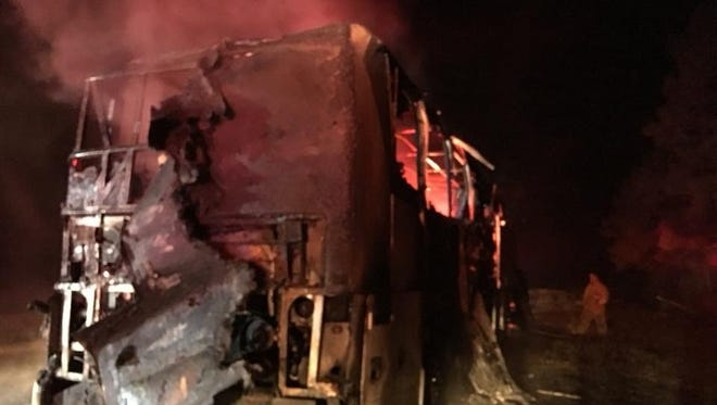 Members of the Navarre High School marching band were evacuated without injuries from a charter bus early on Nov. 18, 2017, after it caught on fire on Interstate 10 while traveling home from St. Augustine, where the school's football team played in a state playoff game.