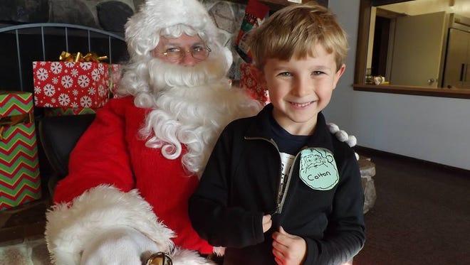 Santa visits with children during Brunch with Santa at Camp Y-Koda.