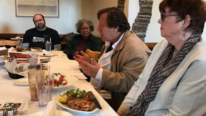 Martin Schwartz, center with arms out, speaks to members of the Montclair Rotary Club on Nov. 28 at Greek Taverna restaurant in Montclair.