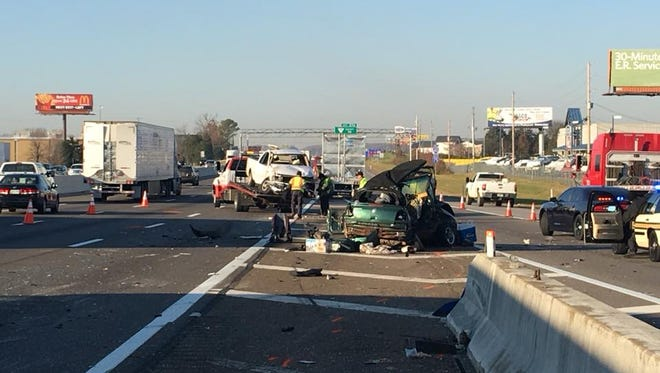 A three-vehicle crash on Interstate 40 West in West Knoxville sent several people to area hospitals with injuries and shut down mulitple lanes of traffic Wednesday morning, Nov. 29, 2017.