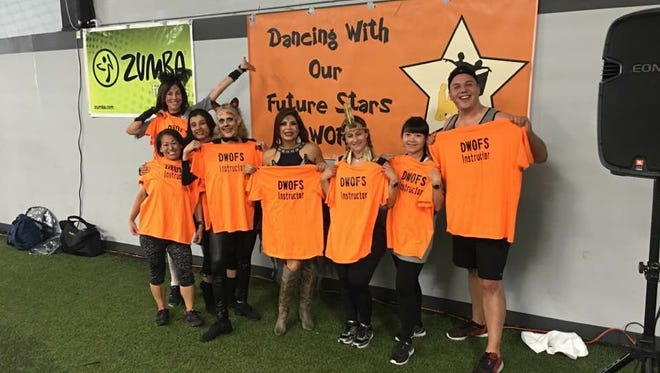 Students will dance in two recitals in December as part of a fitness program. Left to right: Fit 4 The Cause Founder Cindy Rakowitz, Ida Johnson, Zini Joshi, Jolie Ker, Dancing With Our Future Stars Founder and Executive Director Jewell Powell, Liliana Means, Yahui Tsai and Michael Mario Castro, program director.