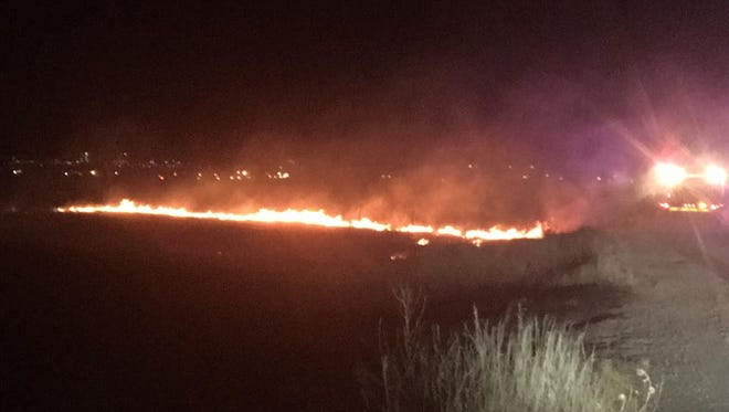 Poudre Fire Authority is investigating the cause of a Monday evening grass fire that burned three acres.