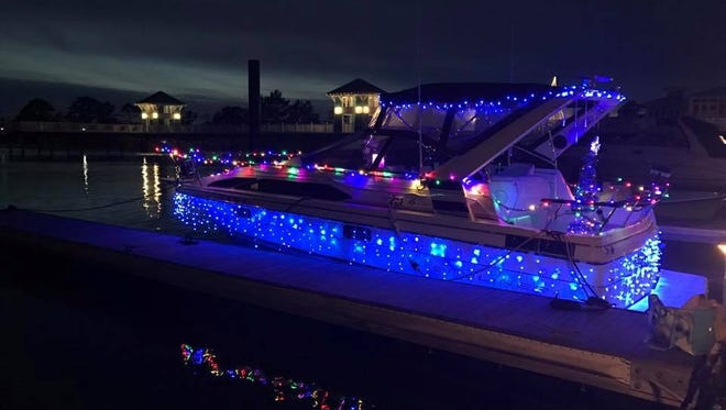A boat shines bright with holiday lights as it takes part in the first Cape Charles boat parade.