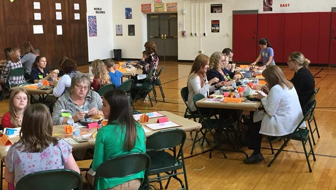 Students at Bucyrus Elementary School enjoy a meal with members of the Bucyrus community during a recent Leadership Luncheon event. The leadership team for the building's Leader in Me program was named the recipient of the $1,000 Bridges Grant from the Bucyrus Education Foundation.