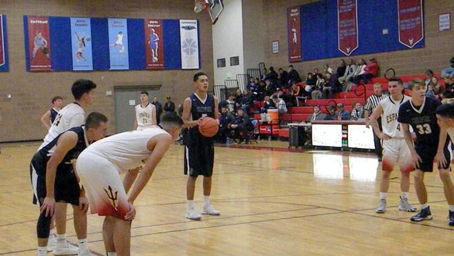 Silver's Jonathan Harris is at the free-throw line during action against top-ranked Espanola Valley at the Sandia Prep Tournament. He finished with 11 points in the contest.