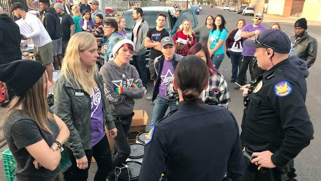 Let's Be Better Humans, Left Coast Burrito Co. and ONe TRUe LOVe giving hygine items, blankets and food before Phoenix police shut it down on Dec. 23, 2017.