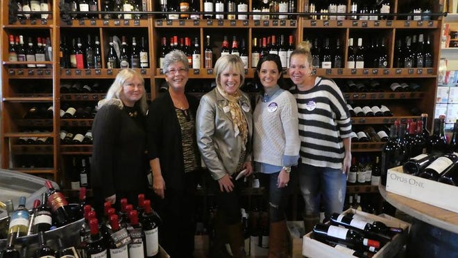 Laurie Welton; We Care Foundation of IRC Executive Director Shelley Stuven; We Care Krewe member Eileen O'Donnell; Lori Ross and We Care Krewe member Tracey Zudans at the 2017 Wine With A Twist fundraiser.